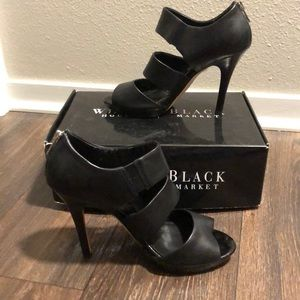 Black high heel open toed sandals.